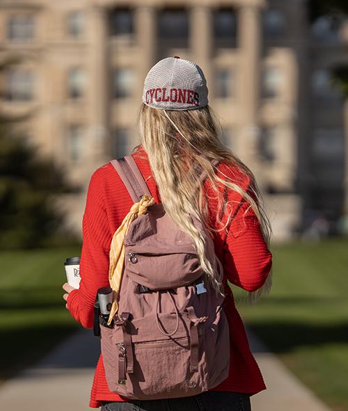 Student walking toward Beardshear Hall