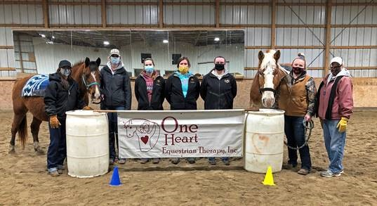 Student volunteers at One Heart Equestrian Therapy during Spring 2021
