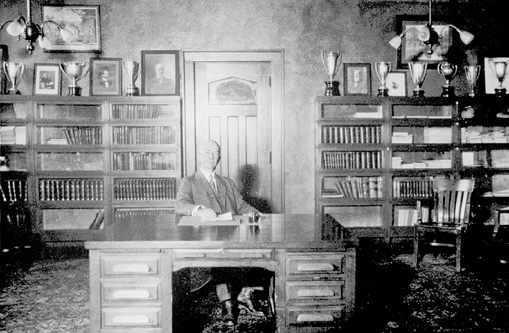 Charles F. Curtiss Working at desk