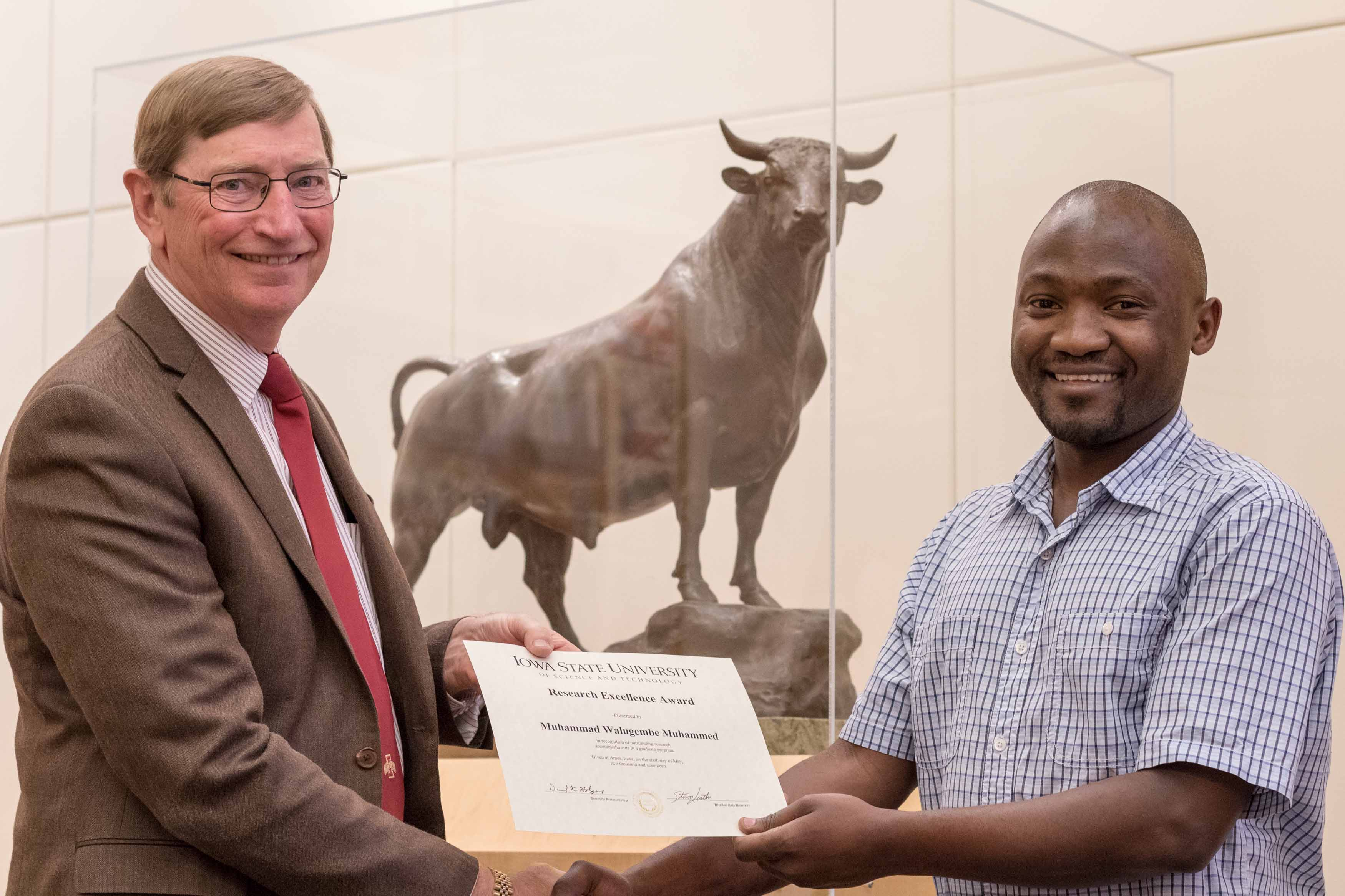 Department Chair Dr. Beermann and scholarship award winner Muhammad Walugembe