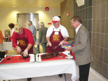 Dr. Cordray  and Ben Ruther serving meat