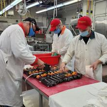Students packaging summer sausage
